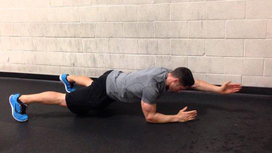 Plank arm raise